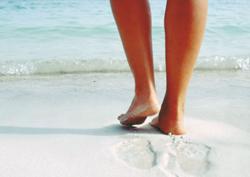 Feet resting on a sandy beach