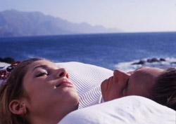A couple sunbathing in Agaete
