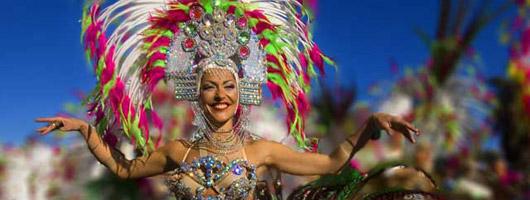 Carnival girl in fancy dress dancing in the streets
