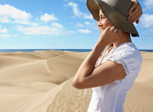 A girl smiling next to the Maspalomas dunes